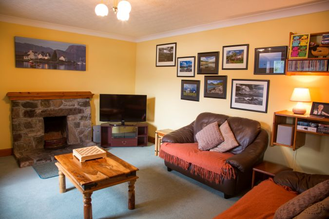 Duart Cottage, Lochcarron, has a comfortable and homely living room with an open fire.