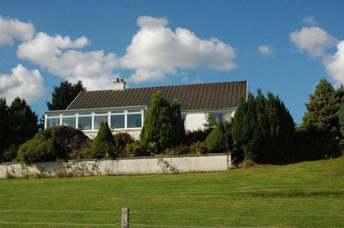 Strathardle is a large modern holiday bungalow situated in a quiet semi-rural position close to the centre of Lochcarron village in Wester Ross, Scottish Highlands.