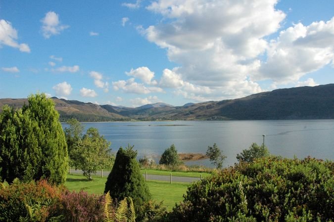 Strathardle stands in an elevated position above Croft Road, Lochcarron, and has magnificent sea and mountain views.