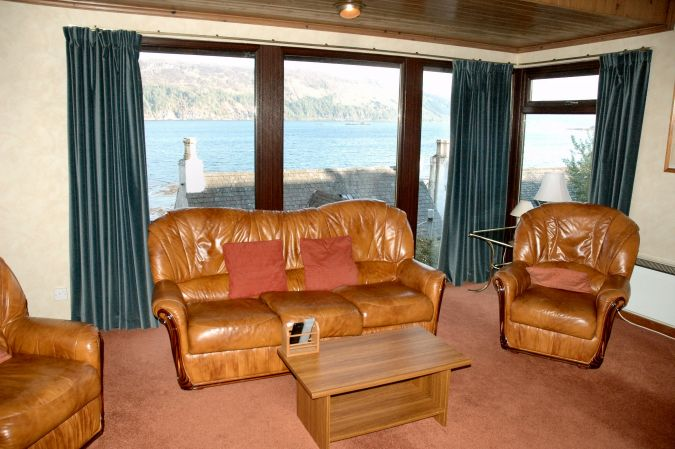 Struan has a spacious open-plan lounge from which there are superb views across Loch Carron to the mountains to the south.