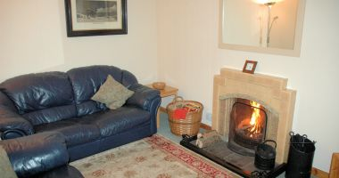 Bruaich Cottage, Lochcarron, has an comfortable and cosy lounge with an open fire.
