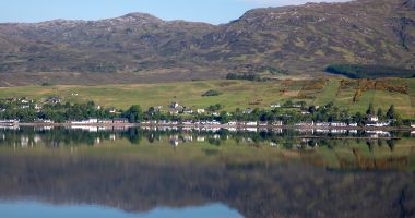 A view of Lochcarron village from the far side of Loch Carron.
