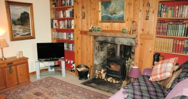 Roseate Cottage, Lochcarron, has a comfortable and cosy lounge with a log-burning stove.
