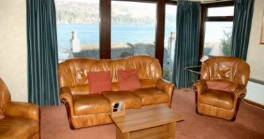 Struan Cottage, Lochcarron, has a light and spacious lounge from which there are superb sea and mountain views.