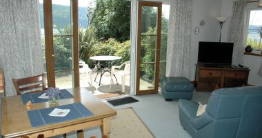 Tigh Charrann, Lochcarron, has a comfortable lounge/dining room from which there are superb sea and mountain views.