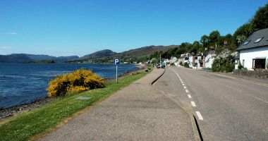 A view looking along the length of the Main Street in Lochcarron.